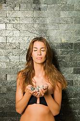 Aug. 23, 2012 - Woman holding stones (Credit Image: © Image Source/ZUMAPRESS.com)