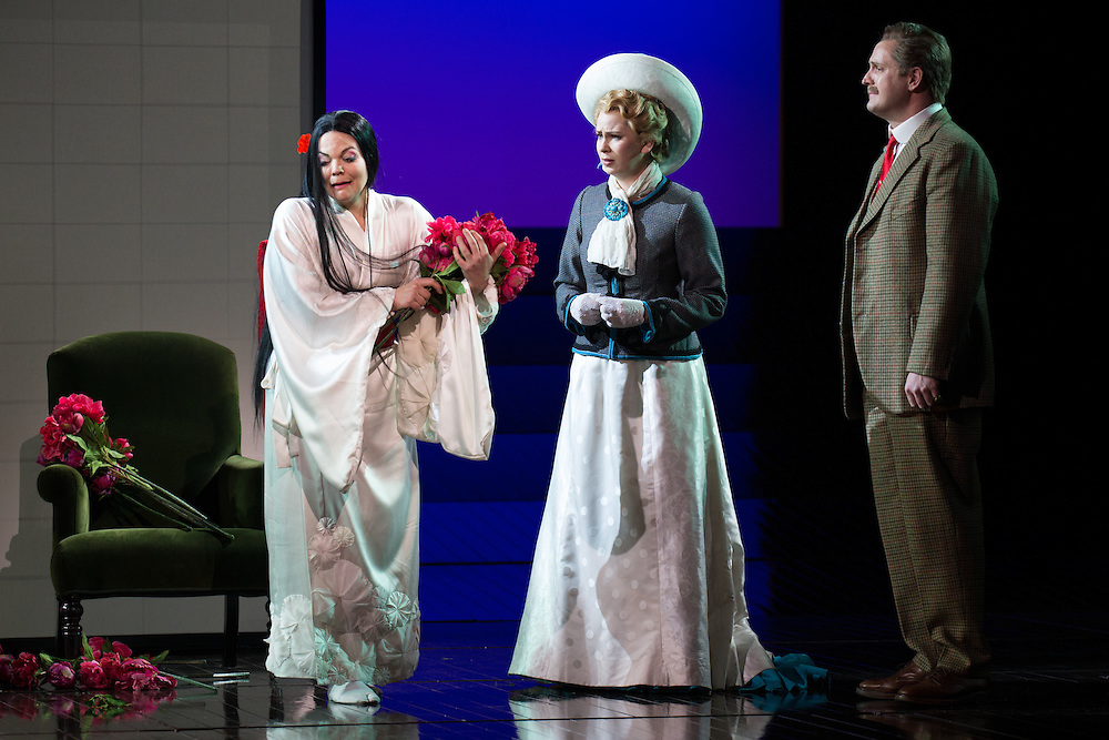 """LONDON, UK, 14 May, 2016. Left to right: Rena Harms, Samantha Price and George von Bergen rehearse for the revival of director Anthony Minghella's production of Puccini's opera """"Madam Butterfly"""" at the London Coliseum for the English National Opera. The production opens on 16 May. Photo credit: Scott Rylander."""