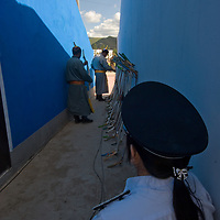 A policewoman guards the entrance to archery events at the national Naadam festival stadium in Ulaanbaatar, Mongolia.