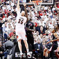 25 April 2016: Portland Trail Blazers center Chris Kaman (35) goes for the baby hook over Los Angeles Clippers forward Jeff Green (8) during the Portland Trail Blazers 98-84 victory over the Los Angeles Clippers, during Game Four of the Western Conference Quarterfinals of the NBA Playoffs at the Moda Center, Portland, Oregon, USA.