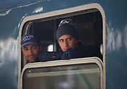 Migrants look from a train travelling from Budapest to Vienna at  the train station in Győr close to the border of Hungary and Austria, September 6 2015.  Hundreds of migrants have resumed their journey through Austria to Germany after Hungary's decision on Friday to let them through.