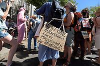 """01 AUG 2020, BERLIN/GERMANY:<br /> Demonstratin mit Schild """"Es gibt keine Bedrohung! Außer die Massnahmen der Regierung!"""", Demonstration gegen die Einschraenkungen in der Corona-Pandemie durch die Initiative """"Querdenken 711"""" aus Stuttgart unter dem Motto """"Das Ende der Pandemie - Tag der Freiheit"""", Unter den Linden<br /> IMAGE: 20200801-01-041<br /> KEYWORDS: Demo, Protest, Demosntranten, Protester, COVID-19, Corona-Demo, Corona-Leugner"""
