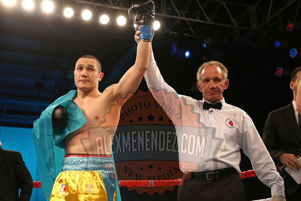 Arman Rysbek defeats John Morehouse during a Telemundo boxing match between at Osceola Heritage Park on Friday, February 23, 2018 in Kissimmee, Florida.  (Alex Menendez via AP)