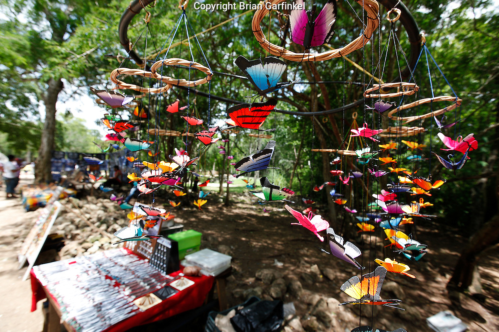 Vendors sell butterfly displays at Chichen Itza Mayan ruins near Piste, Mexico