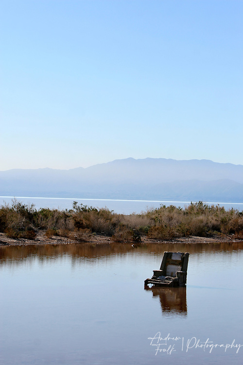 Andrew Foulk/ For High Country News.A lounge chair sits in a lagoon that borders the Salton Sea.