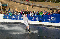 Rob Lamay brought an extra set of hands but they didn't help him make it across the pond during Gunstock's end of season B.Y.O.D.C. event on Sunday afternoon.  (Karen Bobotas/for the Laconia Daily Sun)