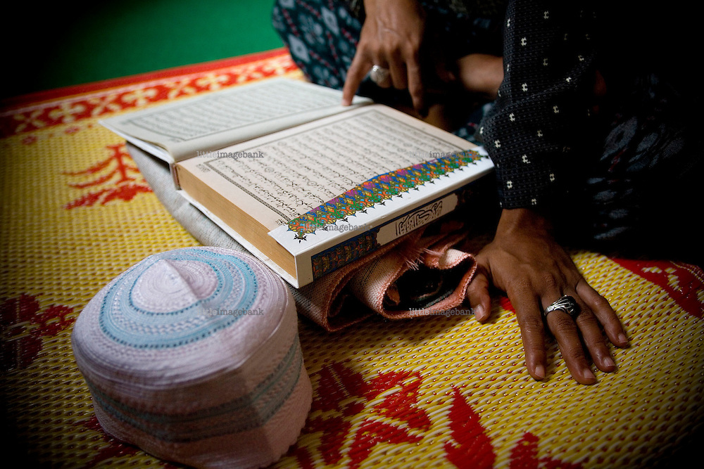 A man reading the holy coran inside the Krue-Se mosque in Pattani. The Krue-Se mosque is a strong symbol of the resistance against the Thai government after a 2004 army raid on the mosque, then housing suspected militants. 30 people where killed inside the mosque by the army. Thailand is struggling to keep up appearances as the land of smiles has to face up to its troubled south. Since 2004 more than 3500 people have been killed and 4000 wounded in a war we never hear about. In the early hours of January 4th 2004 more than 50 armed men stormed a army weapons depot in Narathiwat taking assault rifles, machine guns, rocket launchers, pistols, rocket-propelled grenades and other ammunition. Arsonists simultaneously attacked 20 schools and three police posts elsewhere in Narathiwat. The raid marked the start of the deadliest period of armed conflict in the century-long insurgency. Despite some 30,000 Thai troops being deployed in the region, the shootings, grenade attacks and car bombings happen almost daily, with 90 per cent of those killed being civilians. 17.09.2007, Photo: Christopher Olssøn