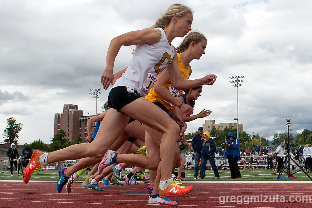 Number one seed, Capital junior Kari Taylor (orange spikes) at the start of the Idaho High School Track & Field State Championships 5A 800 meter run at Dona Larson Park, Boise, Idaho on May 21, 2016. Taylor finished first in 2:14.04.