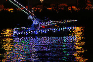 A boat, adorned with Christmas lights, heads out into San Diego Bay during the San Diego Bay Parade of Lights on Sunday, December 21, 2014 in San Diego.  Parade of Lights is a time-honored holiday tradition with more than 80 boats lavishly decorated according to a new theme each year.
