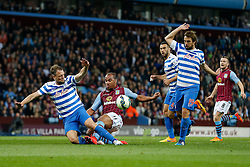 Fabian Delph of Aston Villa is challenged by Clint Hill of QPR - Photo mandatory by-line: Rogan Thomson/JMP - 07966 386802 - 07/04/2015 - SPORT - FOOTBALL - Birmingham, England - Villa Park - Aston Villa v Queens Park Rangers - Barclays Premier League.