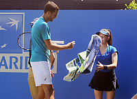 Tennis - 2017 Aegon Championships [Queen's Club Championship] - Day Two, Monday<br /> <br /> Men's Singles, Round of 32<br /> James Ward [GBR] vs. Julien Benneteau [France]<br /> <br /> James Ward on his way to defeat , throws his towel back at the ball girl on Court 1<br /> <br /> COLORSPORT/ANDREW COWIE