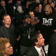Floyd Mayweather speaks to Vladine Biosse after a Showtime Televisions ShoBox:The Next Generation boxing match at the Event Center at Turning Stone Resort Casino on Friday, February 28, 2014 in Verona, New York.  (AP Photo/Alex Menendez)
