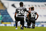 Cameron John of Doncaster Rovers and other players take a knee for Black Lives Matter during the EFL Cup match between Blackburn Rovers and Doncaster Rovers at Ewood Park, Blackburn, England on 29 August 2020.
