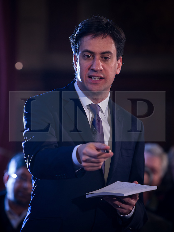 © Licensed to London News Pictures . 29/11/2013 . Manchester , UK . The leader of the Labour Party , ED MILIBAND , with a notebook , addresses an audience at Manchester Town Hall today (Friday 29th November 2013) . The British opposition leader is launching a green paper on energy. Photo credit : Joel Goodman/LNP