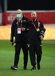 LEUVEN, BELGIUM - Wednesday, March 24, 2021: Wales' head of international affairs Mark Evans (L) and John Smith before the FIFA World Cup Qatar 2022 European Qualifying Group E game between Belgium and Wales at the King Power Den dreef Stadium. Belgium won 3-1. (Pic by Vincent Van Doornick/Isosport/Propaganda)