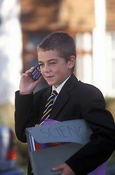 Schoolboy using mobile phone UK