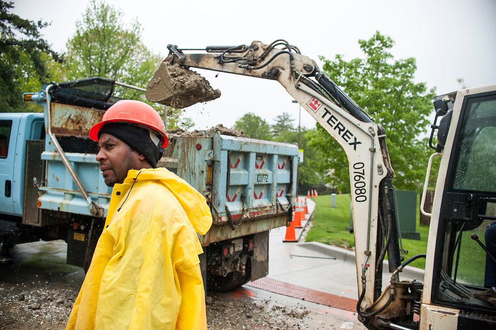 Photo by Matt Roth<br /> <br /> William Spraggins, a laborer with Baltimore City Department of Public Works, responds to a water main break at the intersection of Yellowwood Ave. and Springfield Dr. in Baltimore, Maryland on Tuesday, May 07, 2013.