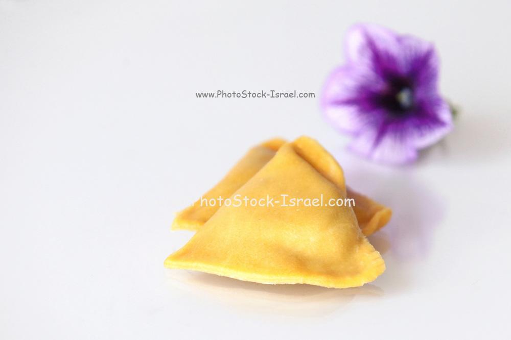 Fresh uncooked Ravioli (Stuffed Pasta) on white background