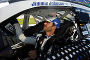 Jimmy Johnson waits for qualifying to begin for a NASCAR Sprint Cup series auto race, Friday, May 9, 2014, at Kansas Speedway in Kansas City, Kan. (AP Photo/Colin E. Braley)