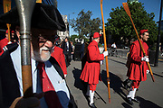 Beating Party made up of students from St Dunstans College, Catford, who return to their roots in the parish of St Dunstan-in-the-East to take part, together with the clergy and the Masters of our associated Livery Companies and oarsmen in red tunics for Beating the Bounds on 25th May 2017 in London, United Kingdom. Beating the Bounds is an ancient custom still observed in many English parishes. Its roots go back to mediaeval times when parishes reaffirmed their boundaries by processing round them at Rogationtide, stopping to beat each boundary mark with wands and to pray for protection and blessings for the land. At All Hallows we beat the bounds of our parish every year on Ascension Day.