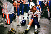 A dejected Christine Fitzpatrick, a member of the New York Gems women's tackle football team, listens to her coach speak as she sits on the locker room floor after losing to the New York Sharks in Hempstead, New York, Friday, December 1, 2000.