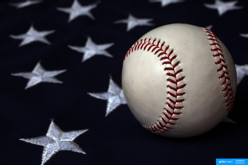 A studio shot of a Baseball on a USA Stars and Stripes Flag. 20th October 2012. Photo Tim Clayton