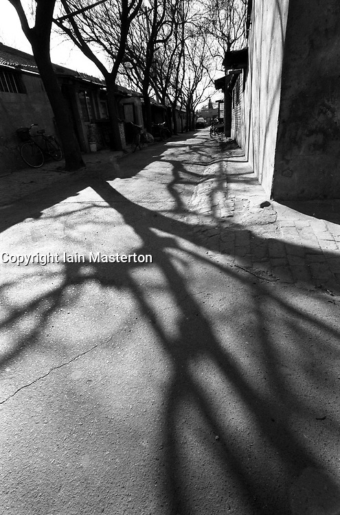 Shadows falling on a narrow alleyway or hutong in Beijing China