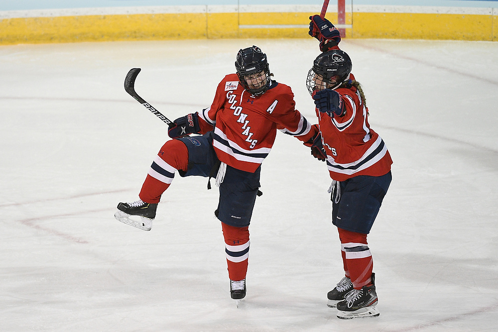 ERIE, PA - MARCH 15: Emily Curlett #5 of the Robert Morris Colonials celebrates with Michaela Boyle #16 after scoring a goal in the second period during the NCAA Tournament Quarterfinals game against the Northeastern Huskies at the Erie Insurance Arena on March 15, 2021 in Erie, Pennsylvania. (Photo by Justin Berl/Robert Morris Athletics)
