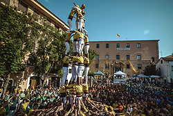 September 30, 2018 - Torredembarra, Catalonia, Spain - The 'Castellers de Castelldefels' build a human tower during the first day of the 27th Tarragona Human Tower Competition in Torredembarra. The competition takes place every other year and features the main 'Castellers' teams (colles) of Catalonia during a three day event organized by the Tarragona City Hall (Credit Image: © Matthias OesterleZUMA Wire)