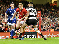 Rugby Union - 2019 / 2020 season - Wales vs. Barbarians<br /> <br /> Johnny McNicholl of Wales  chips ahead, at The Principality (Millennium) Stadium.<br /> <br /> COLORSPORT/WINSTON BYNORTH