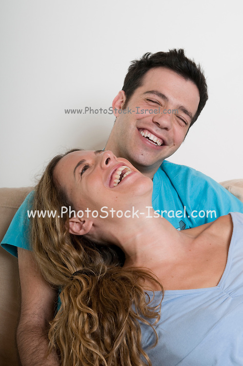 A young couple in their 20s enjoying an intimate moment