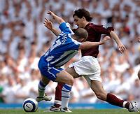 Photo: Daniel Hambury.<br />Arsenal v Wigan Athletic. The Barclays Premiership. 07/05/2006.<br />Arsenal's Cesc Fabregas skips past  Wigan's David Thompson.