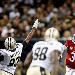 Sep 22, 2013; New Orleans, LA, USA; Arizona Cardinals quarterback Carson Palmer (3) is pressured by New Orleans Saints outside linebacker Junior Galette (93) during a game at Mercedes-Benz Superdome. The Saints defeated the Cardinals 31-7. Mandatory Credit: Derick E. Hingle-USA TODAY Sports