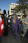Crown Royal man connienye Jackson strols up Royal Street on Fat Tuesady during Mardi Gras festivities in New Orleans Tuesday feb. 28,2006. (Photo/Suzi Altman)