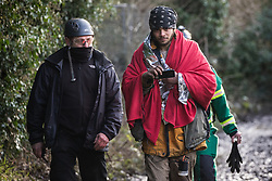 Harefield, UK. 16 January, 2020. Enforcement agents and a paramedic accompany Stop HS2 activist Freeman following his eviction from the Harvil Road wildlife protection camp in the Colne Valley after over two days and two nights taking refuge in a tree in woodland. 108 ancient woodlands are set to be destroyed by the high-speed rail link and further destruction of trees for HS2 in the Harvil Road area is believed to be imminent.
