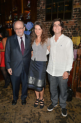 Left to right, SIR SALMAN RUSHDIE, his former wife ELIZABETH WEST and their son MILAN RUSHDIE at a party to celebrate the engagement of Natalie Coyle and Zafar Rushdie held at Library, St.Martin's Lane, London on 6th September 2014.