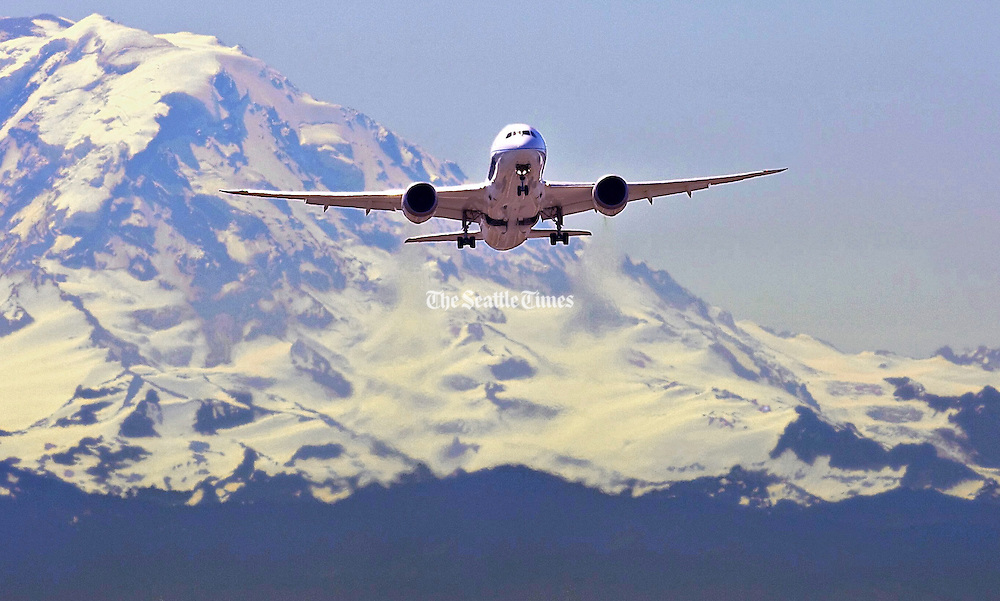 Boeing's number three 787 takes off from Boeing Field for a test flight. Mt Rainier looms in the distance as the 787 takes off. (Mike Siegel / The Seattle Times, 2010)