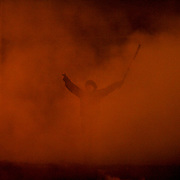A protestor, evolved in smoke, shouts provocative words towards the Ukrainian riot police forces at a defensive barricade near Dynamo Kiev's stadium in central Kiev.