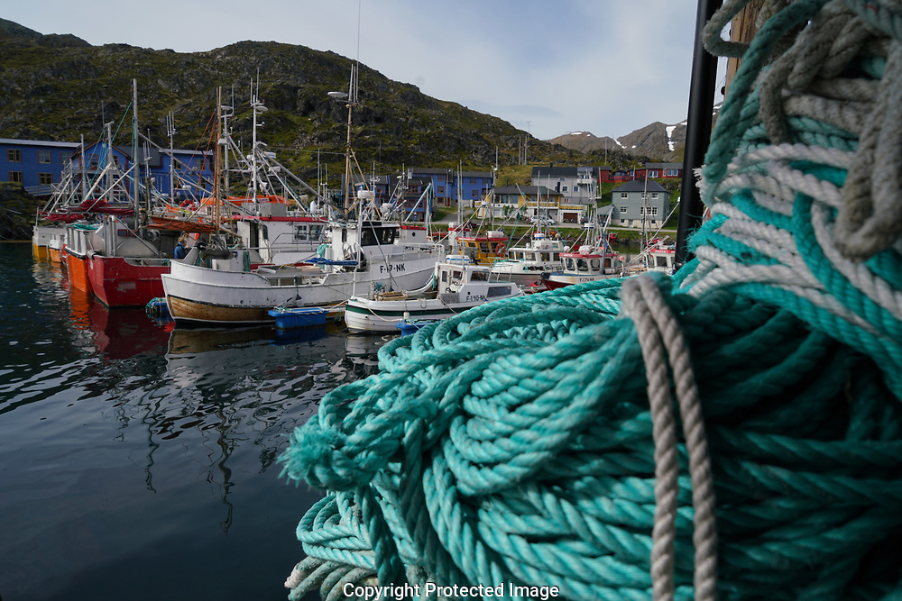 A wharf and fishing boats in the fishing village of Kamoyvaer  Norway. .<br /><br />Photo by Dennis Brack