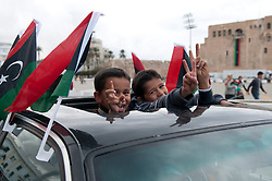 © licensed to London News Pictures. TRIPOLI, LIBYA  17/02/12. Young boys show their support for Libya through a car sunroof in Martyrs' Square in Tripli, Libya. Please see special instructions for usage rates. Photo credit should read MICHAEL GRAAE/LNP