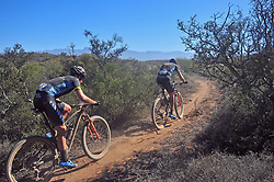 ROBERTSON, SOUTH AFRICA - MARCH 20: Erik Kleinhans follows team mate Jeremiah Bishop up a singletrack climb during stage two's 110km from Robertson on March 20, 2018 in Cape Town, South Africa. Mountain bikers from across South Africa and internationally gather to compete in the 2018 ABSA Cape Epic, racing 8 days and 658km across the Western Cape with an accumulated 13 530m of climbing ascent, often referred to as the 'untamed race' the Cape Epic is said to be the toughest mountain bike event in the world. (Photo by Dino Lloyd)
