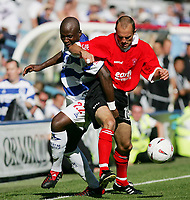 Fotball<br /> 07.08.2004<br /> Foto: SBI/Digitalsport<br /> NORWAY ONLY<br /> <br /> QPR v Rotherham<br /> <br /> The Coca-Cola Championship at Loftus Road.<br /> 07/08/2004<br /> <br /> QPR's Arthur Gnohere fights for the ball against Rotherham's Paul Warne