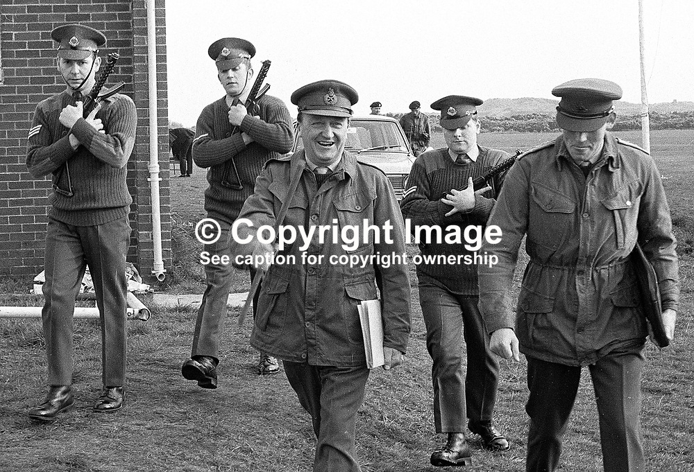 Lieutenant General Harry Tuzo, army supremo in N Ireland, on a visit to Ballykinlar Army Camp, Co Down, is flanked by armed guards. One of the guards (?), Sgt Ken Smyth of the UDR was shot dead 10 December 1971. 197/71, 197104250197c<br /> <br /> Copyright Image from Victor Patterson, Belfast, UK<br /> <br /> t: +44 28 9066 1296 (from Rep of Ireland 048 9066 1296)<br /> m: +44 7802 353836<br /> e: victorpattersonbelfast@gmail.com<br /> <br /> www.images4media.com<br /> <br /> Please see my full Terms and Conditions of Use at https://www.images4media.com/p/terms-conditions - it is IMPORTANT that you familiarise yourself with them.<br /> <br /> Images used online incur an additional cost. This cost should be agreed in writing in advance. Online images must be visibly watermarked i.e. © Victor Patterson or that of the named photographer within the body of the image. The original metadata must not be deleted from images used online.<br /> <br /> This image is only available for the use of the download recipient i.e. television station, newspaper, magazine, book publisher, etc, and must not be passed on to a third party. It is also downloaded on condition that each and every usage is notified within 7 days to victorpattersonbelfast@gmail.com.<br /> <br /> The right of Victor Patterson (or the named photographer) to be identified as the author is asserted in accordance with The Copyright Designs And Patents Act (1988). All moral rights are asserted.