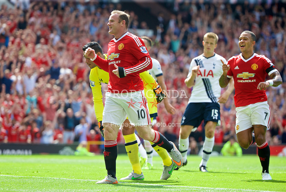 MANCHESTER, ENGLAND - Saturday, August 8, 2015: Manchester United's captain Wayne Rooney celebrates the opening goal against Tottenham Hotspur, an own goal from Kyle Walker, during the Premier League match at Old Trafford. (Pic by David Rawcliffe/Propaganda)