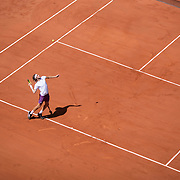 PARIS, FRANCE June 11.  A general view of Stefanos Tsitsipas of Greece serving against Alexander Zverev of Germany on Court Philippe-Chatrier during the semi finals of the singles competition at the 2021 French Open Tennis Tournament at Roland Garros on June 11th 2021 in Paris, France. (Photo by Tim Clayton/Corbis via Getty Images)