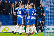 Brighton and Hove Albion (6) Dale Stephens, Brighton and Hove Albion (21) Ezequiel Schelotto, Brighton and Hove Albion (9) Sam Baldock, celebrate goal during the The FA Cup 3rd round match between Brighton and Hove Albion and Crystal Palace at the American Express Community Stadium, Brighton and Hove, England on 8 January 2018. Photo by Sebastian Frej.