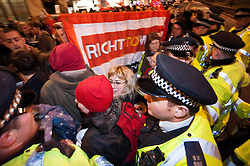 © licensed to London News Pictures. London, UK. 15/02/12. Police move to clear protestors blocking Park Lane. Electricians from Balfour Beatty Engineering Services (BBES) & activists hold a demonstration outside of the Electrical Contractors Association dinner at the Grosvenor Hotel in London, causing serious traffic disruption on Park Lane. On 2 February Unite members at Balfour Beatty Engineering Services (BBES) voted for a second time to strike over what they claim is the termination of long-held agreements and the de-skilling of construction workers.   Photo credit: Jules Mattsson/LNP