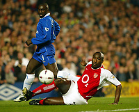 Photo: Scott Heavey<br />Chelsea v Arsenal. FA Cup quater final replay.<br />25/03/03<br />Sol Campbell slides in to evade Hasselbaink a scoring opportunity during this London derby.