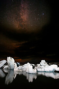 The Milky Way shines over the icebergs floating in Jökulsárlón, the glacial lagoon in southeast Iceland. The icebergs floating in the lake calved off from the Breiðamerkurjökull glacier with some of the ice being more than 1,000 years old. Jökulsárlón covers an area of about 18 square kilometers (6.9 square miles) and ranks as the deepest lake in Iceland.