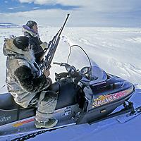 BAFFIN ISLAND, Nunavut, Canada. Inuit hunters Laimake Palluq & Jayko Apak look for seals on Frozen Baffin Bay.